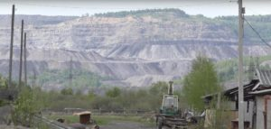 Gigantic open pit coal mines destroy Shor sacred sites and poison the Shor's drinking water, rivers, air and land.